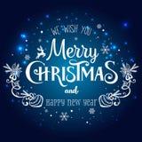 Jul och nytt år som är typografiska på feriebakgrund med snöflingor, ljus, stjärnor också vektor för coreldrawillustration Arkivbilder