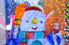 Jul och nytt års snögubbe Arkivbilder