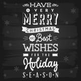 Jul och svart tavla för semesterperiodhälsningar Arkivfoton