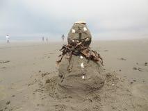 Jul på stranden sandman arkivfoto