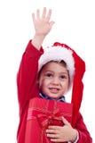 Jul pojke och present Fotografering för Bildbyråer