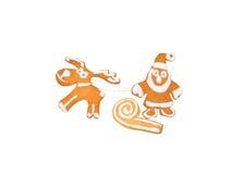 Jul ren och Santa Claus på pulkakakorna Royaltyfri Bild