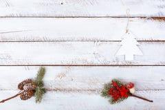 Jul sänker lekmanna- minsta på den vita tabellen Arkivfoto