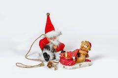 Jul Santa Claus med en julljus Arkivbild