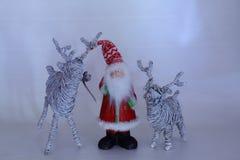 Jul - Santa Claus och ren två Royaltyfri Foto