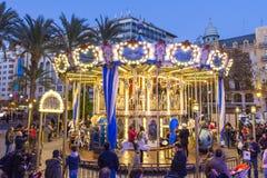 Jul som är ganska med karusell på den Modernisme plazaen av stadshuset av Valencia, Spanien Fotografering för Bildbyråer