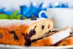 Jul som är ljusbrun med blåbäret Royaltyfri Foto