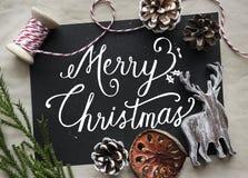Jul som önskar kortet med prydnaden Fotografering för Bildbyråer