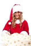 jul som öppnar aktuellt kvinnaxmas-barn royaltyfri foto