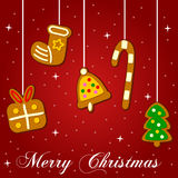 Jul som hänger kakor på rött Royaltyfria Bilder