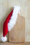 Jul som lagar mat abstrakt bakgrund med den Santa Claus hatten Arkivfoto