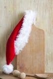 Jul som lagar mat abstrakt bakgrund med den Santa Claus hatten Fotografering för Bildbyråer