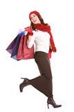 Jul: Upphetsad shoppare med shoppingpåsar Arkivfoto