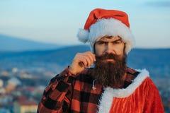 Jul utomhus- dåliga santa arkivfoto