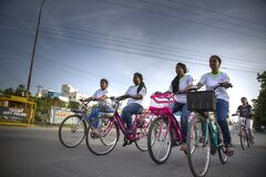Low angle front view of young girls riding the bicycles for a cyclothon event