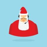 Julappellmitt Santa Claus och hörlurar med mikrofon Jultomten reagerar t Royaltyfri Foto