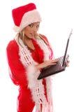 julbärbar dator s santa Arkivfoton