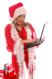 julbärbar dator santa arkivbilder