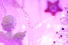 Julbakgrund av bokeh tänder med en ängel och en stjärna Fotografering för Bildbyråer