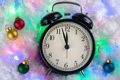 Julbakgrund av klockor och leksaker royaltyfria bilder