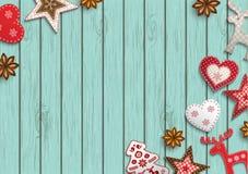 Julbakgrund, den lilla scandinavianen utformade garneringar som ligger på den blåa träbakgrunden, illustration stock illustrationer