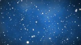 Julbakgrund - glödande snöpartiklar - blå bakgrund stock video