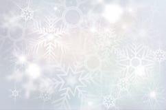 Julbakgrund med abstrakta snöflingor Arkivbilder