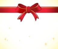 Julbakgrund med den röda pilbågen och bandet Arkivbild