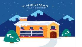 Julbakgrund med det snöig huset Arkivfoton