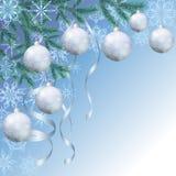 Julbakgrund med filialer och bollar Arkivfoto
