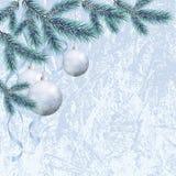 Julbakgrund med filialer och bollar Arkivbilder