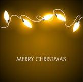 Julbakgrund med guld- lampor Arkivfoton