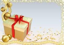 Julbakgrund med guld- prydnader Arkivbild