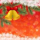Julbakgrund med guldklockor och Arkivfoto