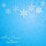Julbakgrund med hängande snöflingor Arkivbilder
