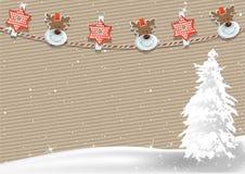 Julbakgrund med klädnypagarnering Arkivbild