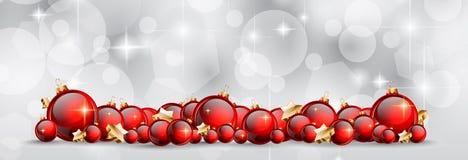 Julbakgrund med röda skinande struntsaker för din säsongsbetonade Fl Royaltyfri Foto