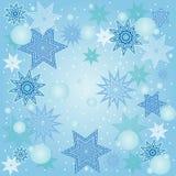 Julbakgrund med snöflingor. Arkivbilder