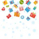 Julbakgrund med snöflingor och gåvaaskar Arkivbild