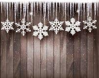 Julbakgrund med snöflingor och istappar Royaltyfri Bild