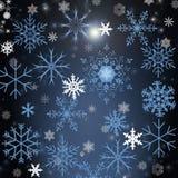 Julbakgrund med snowflakers Arkivbilder