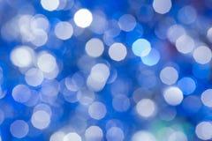 Julbakgrund med suddighetsljus arkivfoto