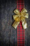 Julband och guld- gåvapilbåge Fotografering för Bildbyråer