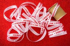 Julband på ljus röd bakgrund Royaltyfri Foto