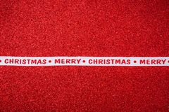 Julband på ljus röd bakgrund Arkivfoton