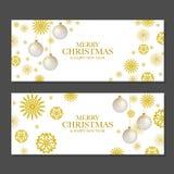 Julbaner med guld- snöflingor Arkivfoto