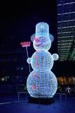 Julbelysningar i Berlin - snögubbe Arkivfoto