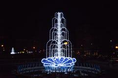 Julbelysningar i en springbrunn Arkivfoton
