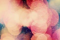 Julbokehbakgrund och snöhäftig snöstorm royaltyfri fotografi