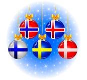 Julbollar med flaggor av skandinavet Arkivbild